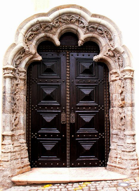 Elvas,Portalegre,Portugal outstanding door gate portal in a stone arch carved wall in metal black and bronze studded details