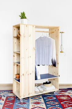 Clothing rack with bookcase. Adds spots for tiny things. Might need more visibility for those cubbies.