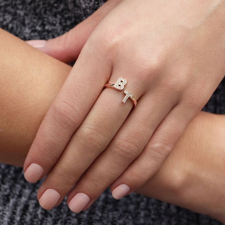 A fresh take on initial jewelry, the simplicity of this staggered ring is perfect for anyone looking for a modern way to wear a sentimental piece. Customize this diamond rose gold ring with your spouse's, child's or your own initials.  All customized ring…