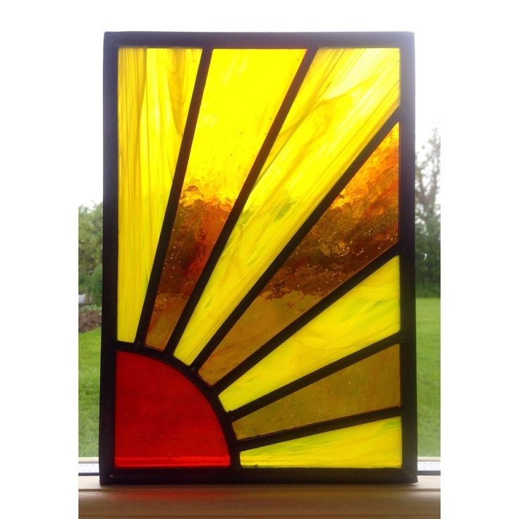 I have made this stained glass panel using the traditional stained glass technique as used in church stained glass windows using a range of different colours of stained glass to create a sun design, which is beautifully shown with light shining through.   eBay!