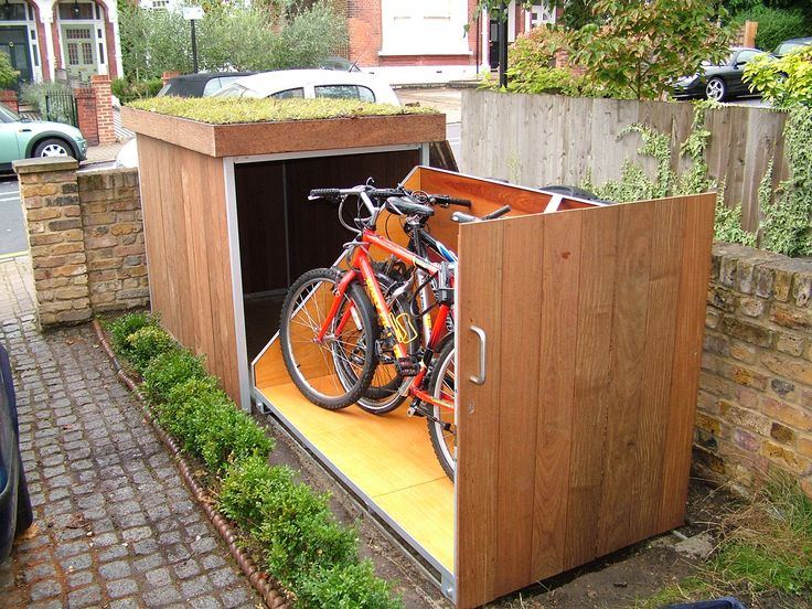 Bike storage with green roof in front garden. I'd add a lock.