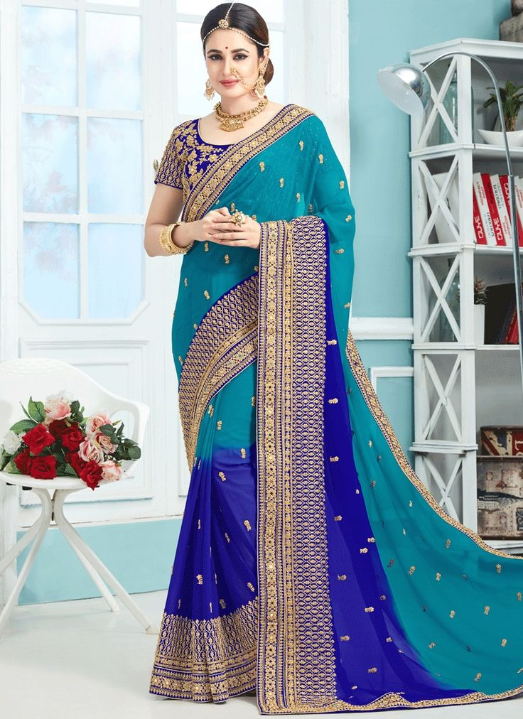 Online shopping in india for women for clothing, sarees. Buy this captivating faux chiffon and faux georgette blue classic designer saree.