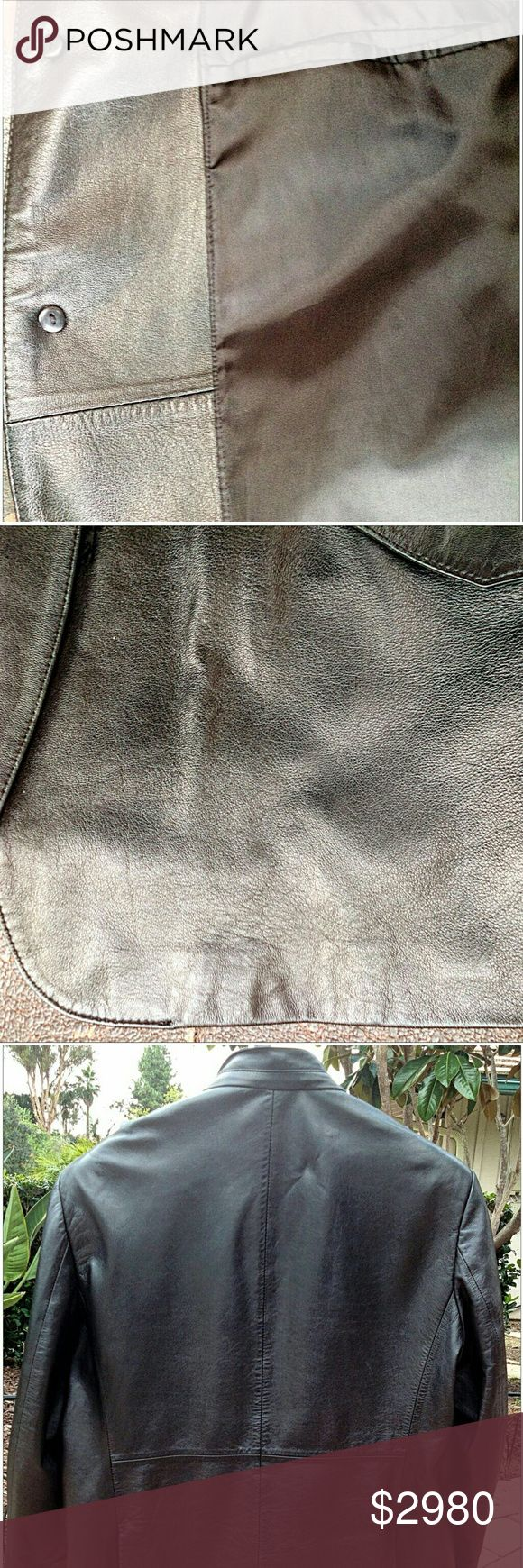 armani Authentic, Original and One-of-a-Kind Giorgio Armani Leather Jacket, with Hidden Button Closure and Mandarin Collar. Exclusive Hand-Crafted Black Jacket made from extremely Soft, Smooth and Comfortable 100% Lambskin Leather. The Chic Jacket is a combination between Classic Motorcycle and Armani Flare. It is rather light for its construction and warm and perfect for Fall or Winter temperatures.  Jacket has Two (2) Front Flap Pockets and Two (2) Concealed Interior Breast Pockets.   This…