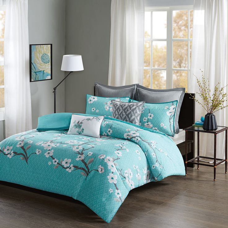 The Madison Park Holly 7 Piece Duvet Cover Set will add charm and elegance to your bedroom décor. A lovely floral pattern is beautifully printed on the teal duvet cover. Matching shams gracefully spread the floral motif to the head of the bed, while the grey Euro shams provide a pleasant touch of neutral color. Two decorative pillows complete the look using fabric manipulation and embroidered details for added dimension and texture.