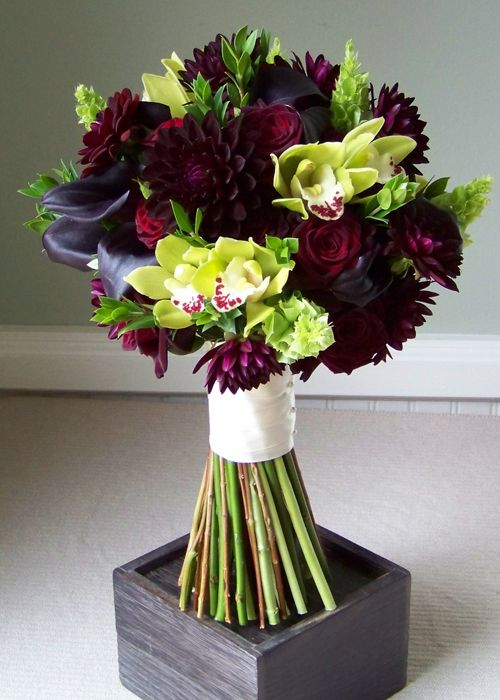 bridal bouquet with Hot Chocolate mini callas, burgundy dahlias, Black Bacarra roses, Mariska spray roses, green cymbidium orchids, bells of Ireland, and myrtle