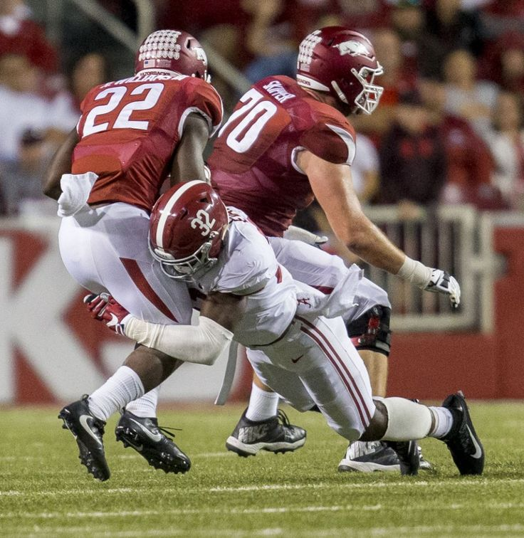 Alabama linebacker Rashaan Evans (32) stops Arkansas running back Rawleigh Williams III (22) during the second half of Alabama's SEC football game at Arkansas, Saturday, Oct. 8, 2016, at Donald W. Reynolds Razorback Stadium in Fayetteville, Ark.  Vasha Hunt/vhunt@al.com
