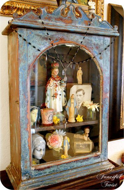 absolutely love this! Will be on the hunt for an old medicine cabinent and religious icons this summer :)