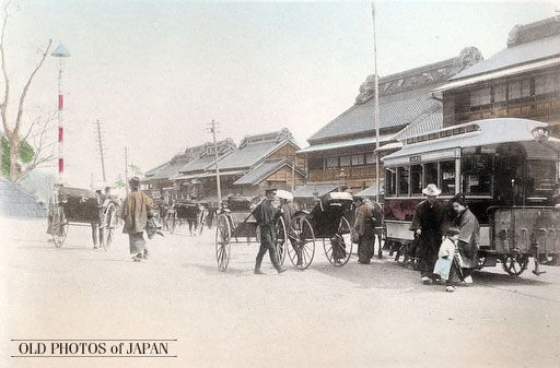 Tokyo in the 1890's. This photograph displays Tokyo's most popular transportation modes during the Meiji Period (1868-1912), horse drawn streetcars and jinrikisha (rickshaws). A small family is stepping out of the streetcar, most probably on their way to visit the new Ueno Park, a favorite attraction during this period.