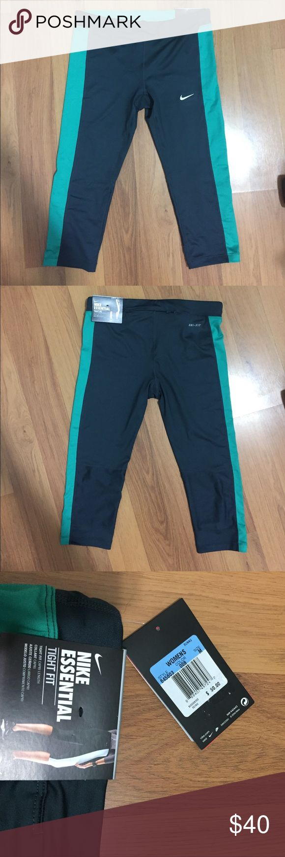 Nike capri size medium Brand new! Received as a gift but doesn't fit. Dark gray with green stripes on sides. Capri length. Dri fit Nike Pants Capris
