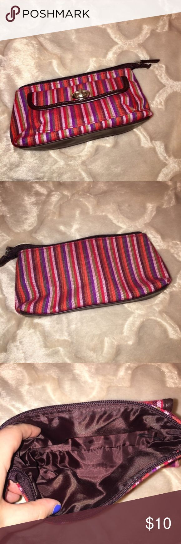Striped Estee Lauder Makeup Bag Red, pink and purple striped Estee Lauder makeup bag. Inside is brown. Zips and has a compartment on the outside that locks and you have to twist open.  Free gift included with purchase. Estee Lauder Bags Cosmetic Bags & Cases