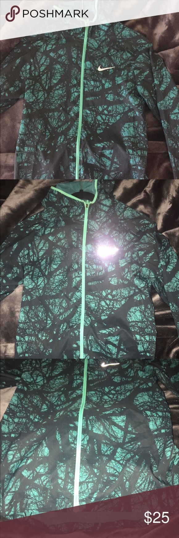Women's Nike jacket! Light-weight Blue, green nice light running/ leisure jacket! Never worn and in perfect condition! Super comfy and light Nike Jackets & Coats
