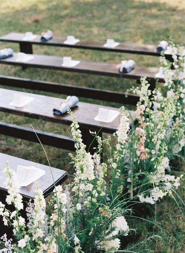 Rustic Wedding Ceremony with Vintage Benches and Wildflower Aisle Decor | Austin Gros Photography | http://heyweddinglady.com/sweetest-spring-wedding-palette-ever/