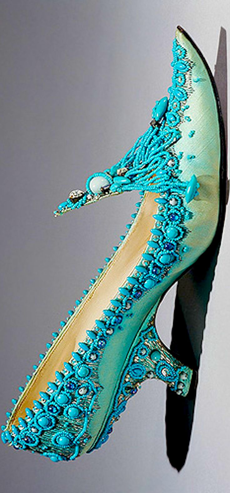 Evening Shoes by Roger Vivier 1961. Using the signature comma heel and embroidery of glass beads, rhinestones, and silver metallic thread on aqua satin to create an exquisite piece