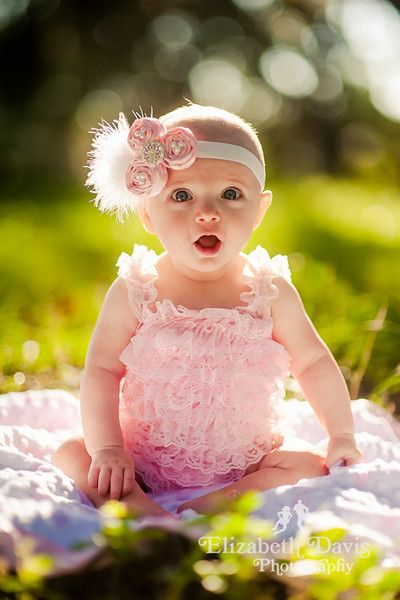Elizabeth davis photography baby session with baby girl in pink outdoors in sunshine