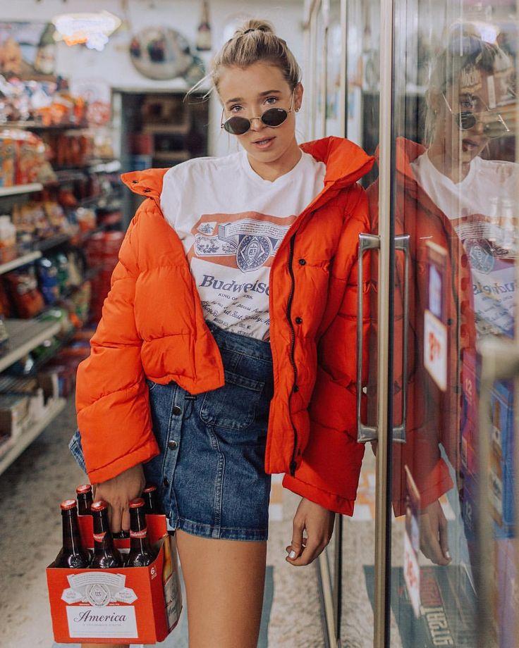 Budweiser t-shirt with orange puffer coat and denim skirt