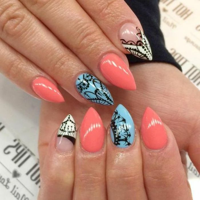 lace like pattern, hand drawn in black, on short stiletto nails, in coral pink, light blue and white, and clear nail polish