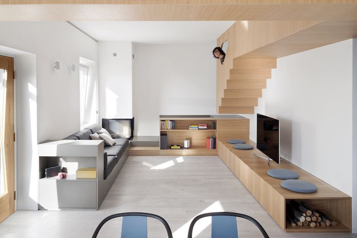 a huge wooden, suspended, cross-shaped furniture manages the whole house inspired by el lissitzky\'s proun.