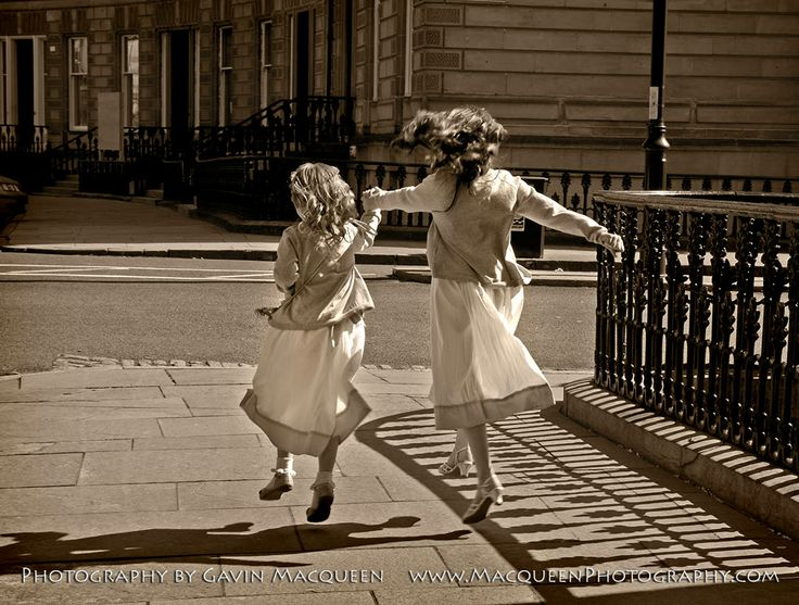 Wedding flower girls just after the service in Park Circus Registry Office, in the West End of Glasgow.