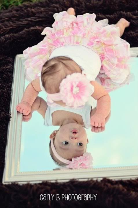 Cute birthday picture idea even with a toddler that is sitting up and looking down at the mirror.