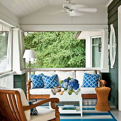 "Classic Nautical Porch | ""This porch overlooks the Severn River, so the decision to use blue seemed natural,"" said designer Kelley Proxmire. ""The pop of crisp white brings it all to life."" 