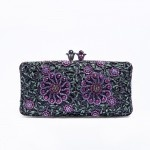 Martine.  Going out for dinner?  Take this clutch for an evening of elegance.  Understated but extremely elegant.  Mollie Day.