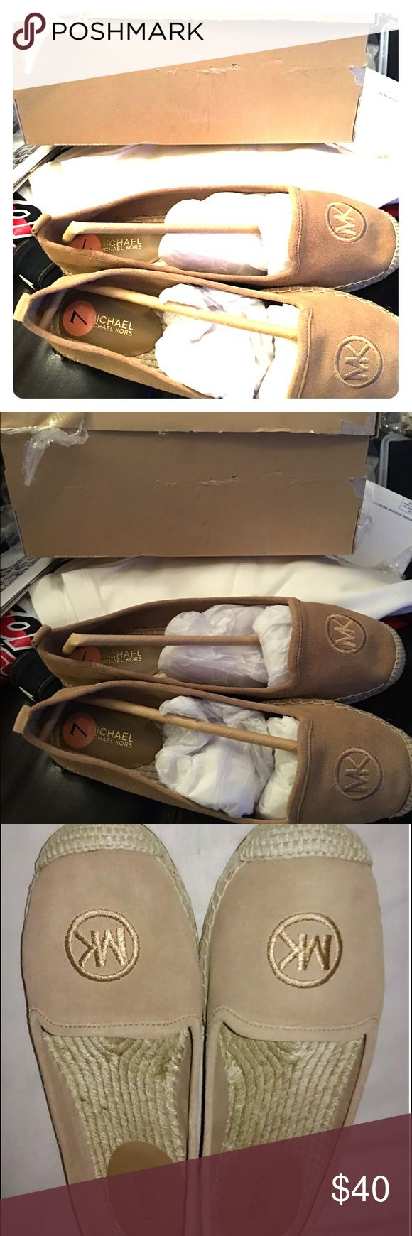 Brand New Beautiful Michael Kors espadrilles. These beauties are beige espadrilles made my Michael Kor's. Size says 7 but they run big. They fit more 7.5-8. New, never worn. KORS Michael Kors Shoes Espadrilles