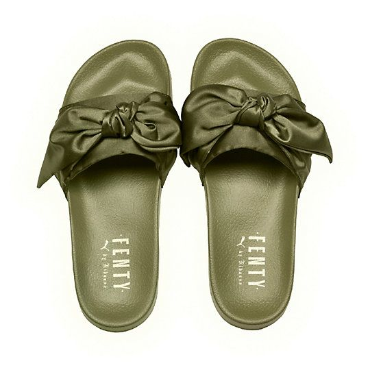 <p>Influenced by the luxurious Parisian days of Marie-Antoinette, the Bow Slide by FENTY takes the classic soccer slide up a bunch of notches. A beautiful satin bow adorns the slide strap, with a satin foam backing for comfort. Sure to be a hit for those who loved the Fur Slides from 2016.</p><p>Features</p><ul><li>Satin Bow constructed on strap</li><li>Satin Foam Backing</li><li>FENTY PUMA BY RIHANNA emblazoned o...
