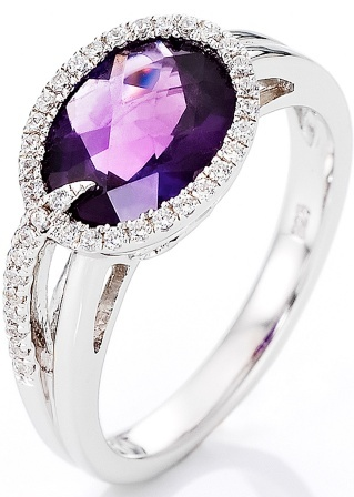 silver ring with a purple stone