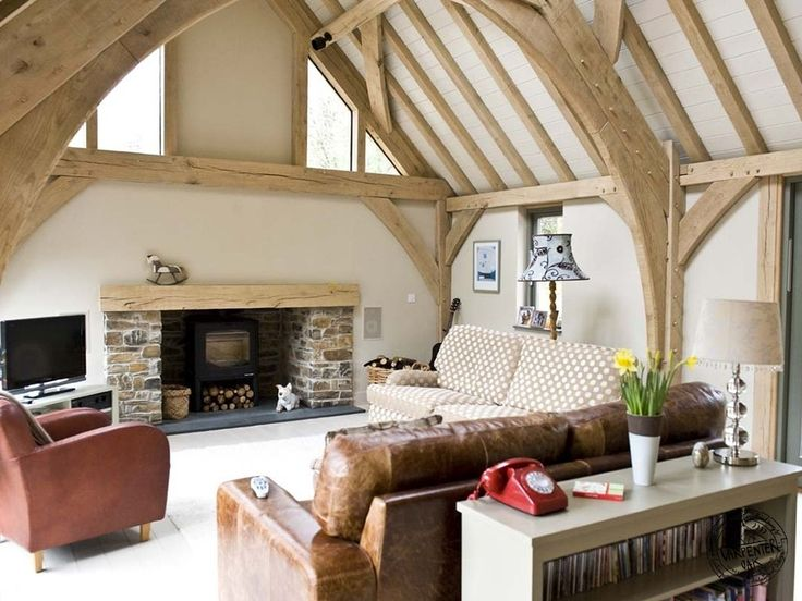 Oak framed houses by Carpenter Oak Ltd