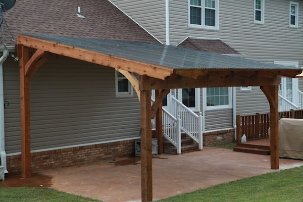 Free standing pergola with polycarbonate roof panels to keep out the rain and to provide shade.
