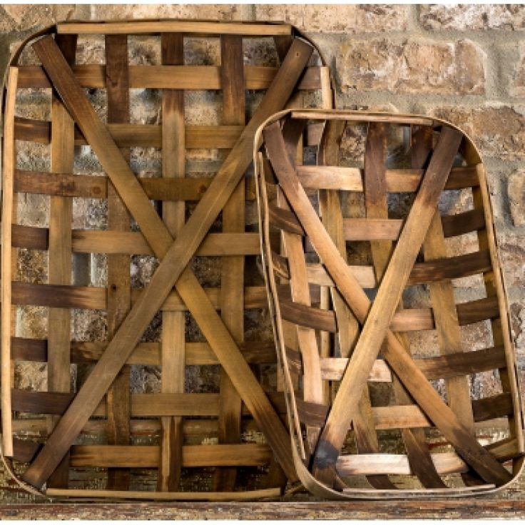 These tobacco baskets have been beautifully reproduced, featuring wood strips interwoven within a wood rim, and are perfect for adding texture and interest to any wall or mantel.