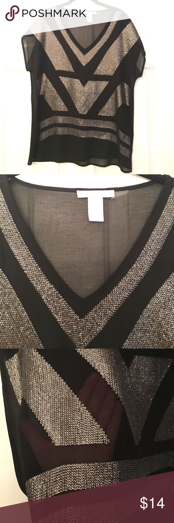 Sparkly sheer black/silver blouse Sparkly sheer black/silver blouse. You can wear a pretty lace bralette underneath for a sexy look or a tank for a more reserved look Design History Tops Blouses