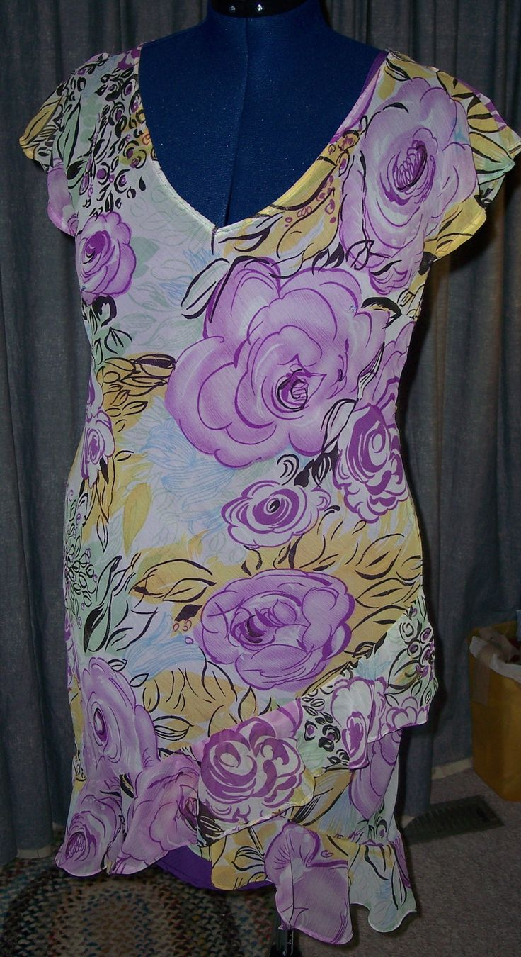 This is a lovely sheer print over a solid slip dress.