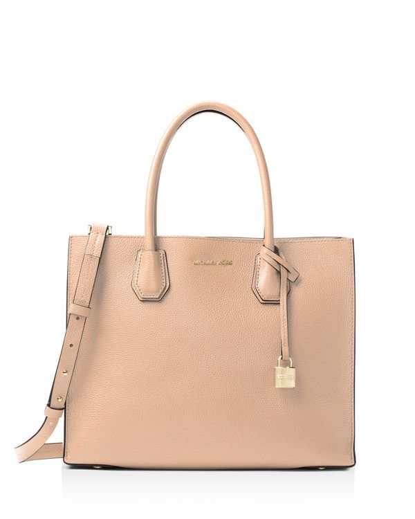 With a sharply tailored silhouette and shining lock hardware, this convertible Michael Michael Kors Studio tote is supremely sophisticated for day or play. | 100% Cow Leather. | Imported | Double hand