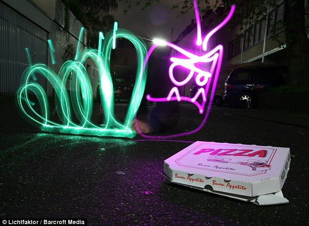 Litter bug: An angry caterpillar looks down at a pizza box in Cologne, Germany