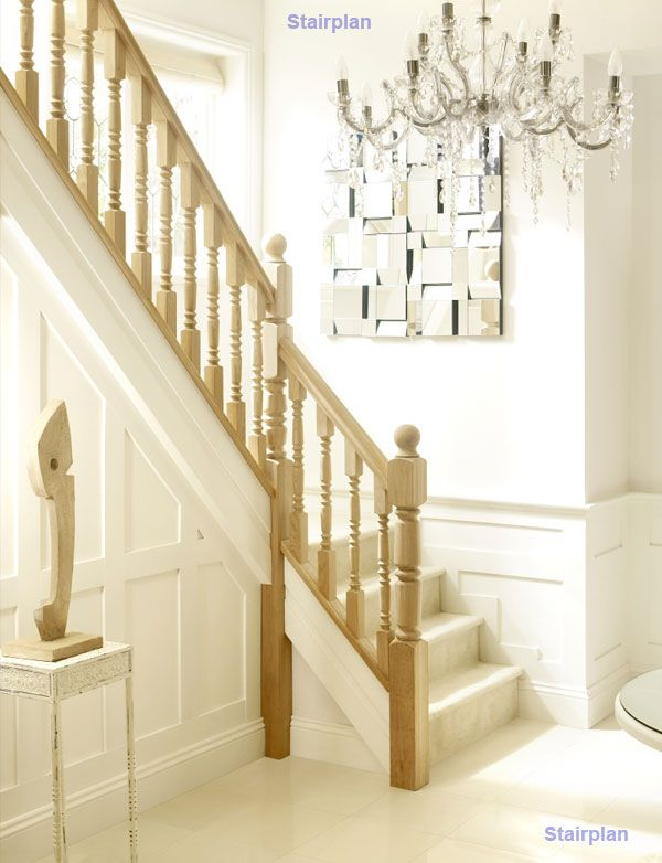 Oak staircase and white panelled walls together