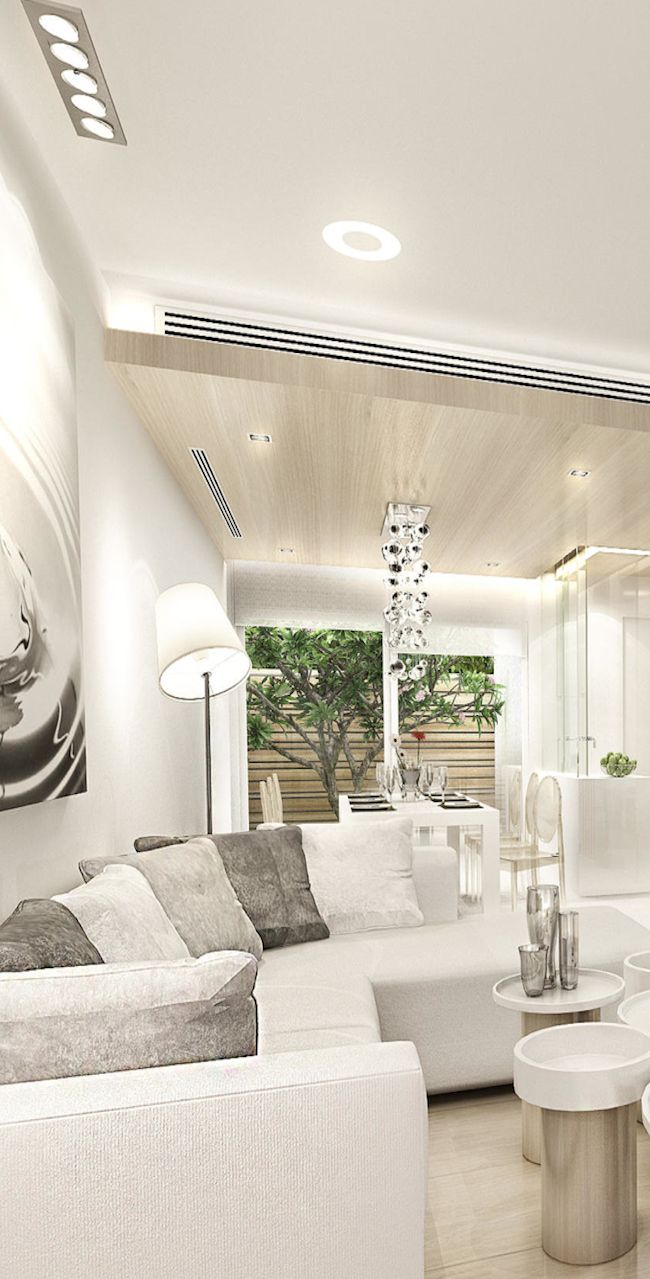 What do you think of this space? Looks clean and elegant, but is the tilted lampshade an oversight, or part of the design? Bplus Art and Design Consultant.