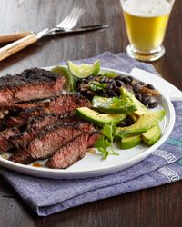 Carne Asada with Black Beans | Chef Way: At Frontera Grill in Chicago, Rick Bayless serves this classic dish that combines grilled marinated steak, fried plantains, homemade black beans and fresh guacamole. Easy Way Trim the dish back to a simple duo of spice-marinated rib eye steaks and canned black beans served with avocado.
