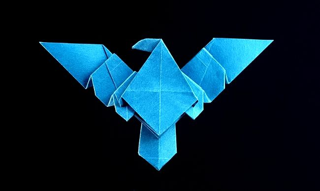 Origami Nightwing symbol by John Montroll Folded from a square of Satogami paper by Gilad Aharoni on www.giladorigami.com