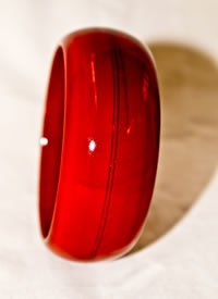 A wide wooden Bangle