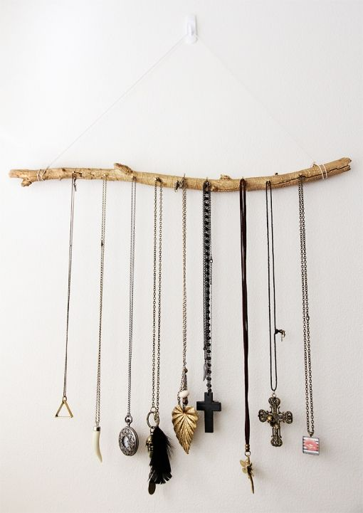 Tree branch hanging jewellery display.