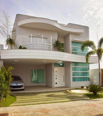Fachadas minimalistas con balcon baranda curva