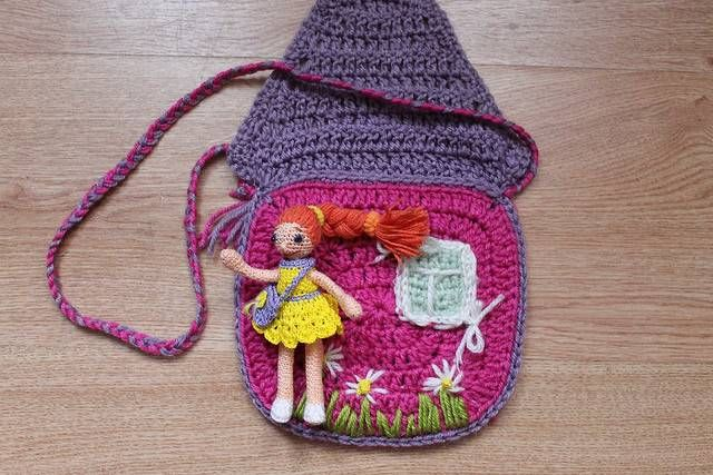 Tiny doll is living at small handbag!^___^. It's crocheted by me. It's a gift for little pretty girl!)))