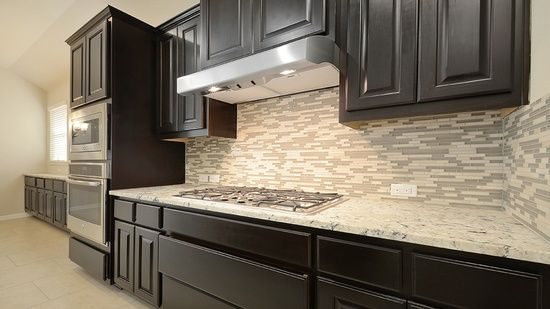 Wentworth - Crystal Falls Mesa Oaks by Taylor Morrison. Kitchen. dark cabinet. light backsplash