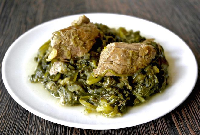Greek pork and greens with lemon juice