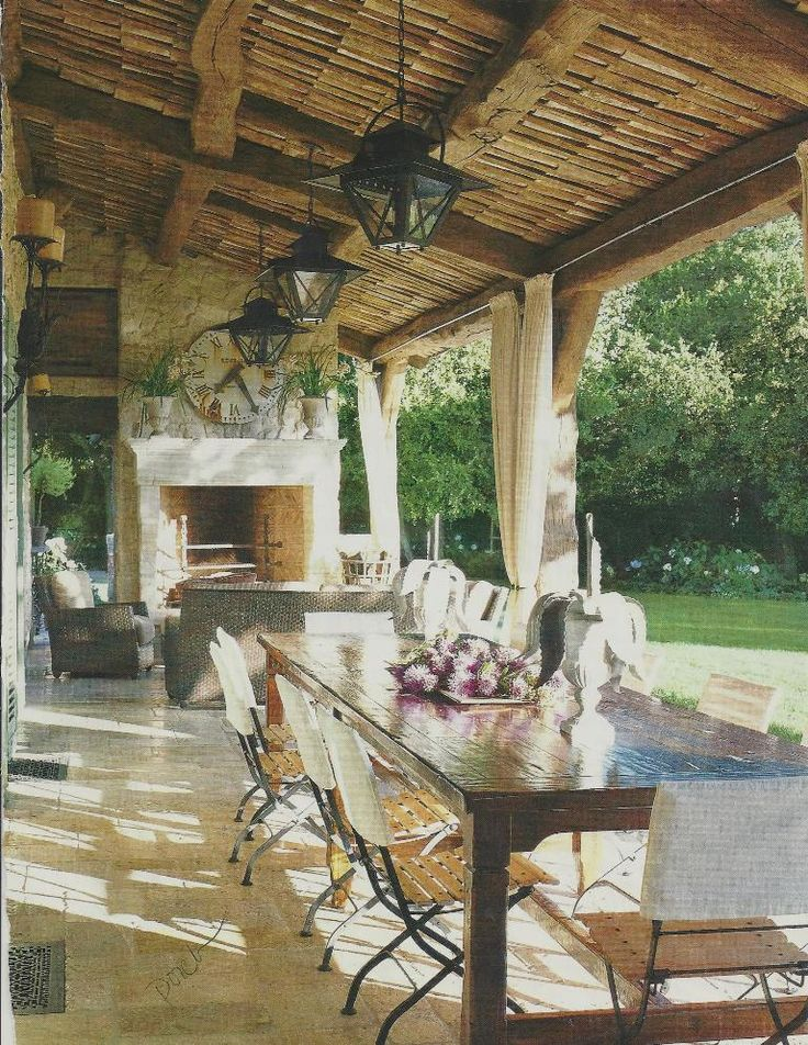 outdoor living...  I designed a space like this. Took the ceiling and used sheets of Bamboo Fence