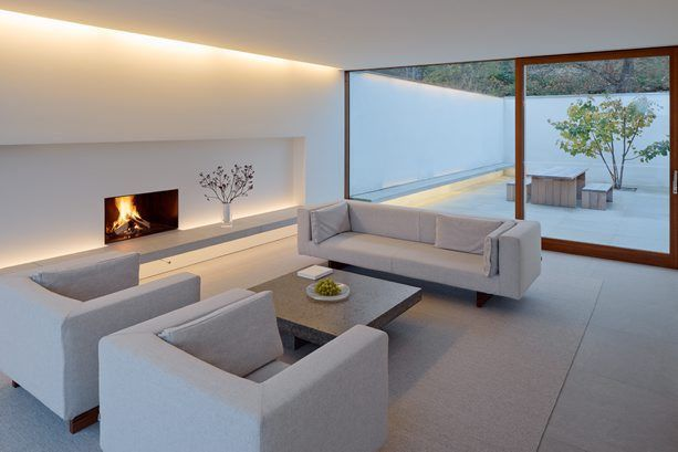 contemporary minimal white fireplace with concealed lighting || The Palmgren House – John Pawson | V Söderqvist