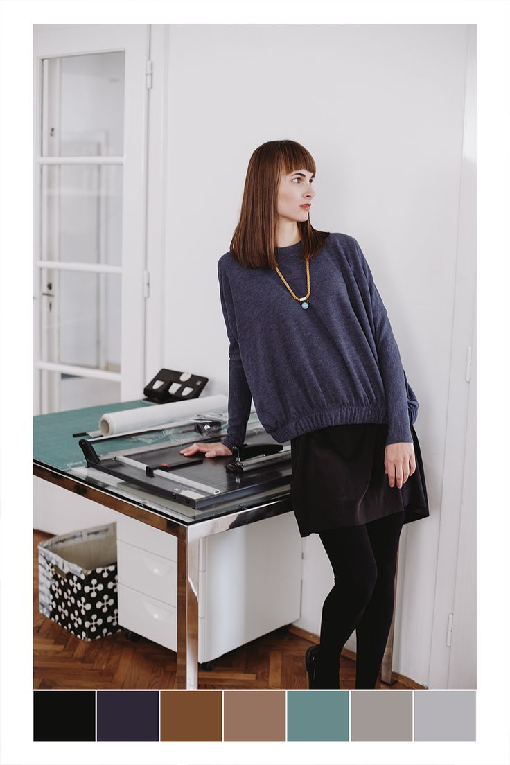 POKOJÍK / Hani wears blue sweatshirt by Theó, black skirt by About and a necklace by Sew a song