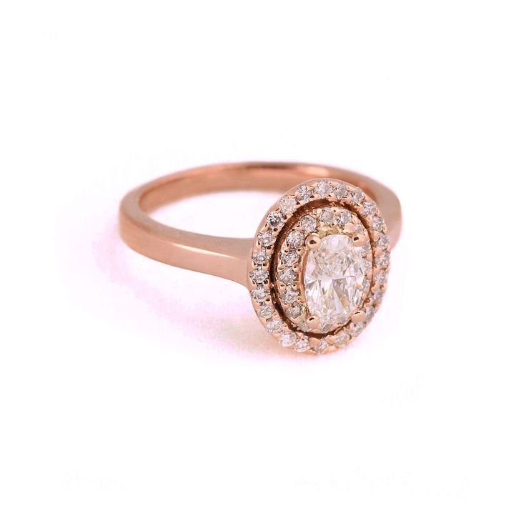 Ring by Jenny Greco.  Rose gold, oval centre diamond with double halo
