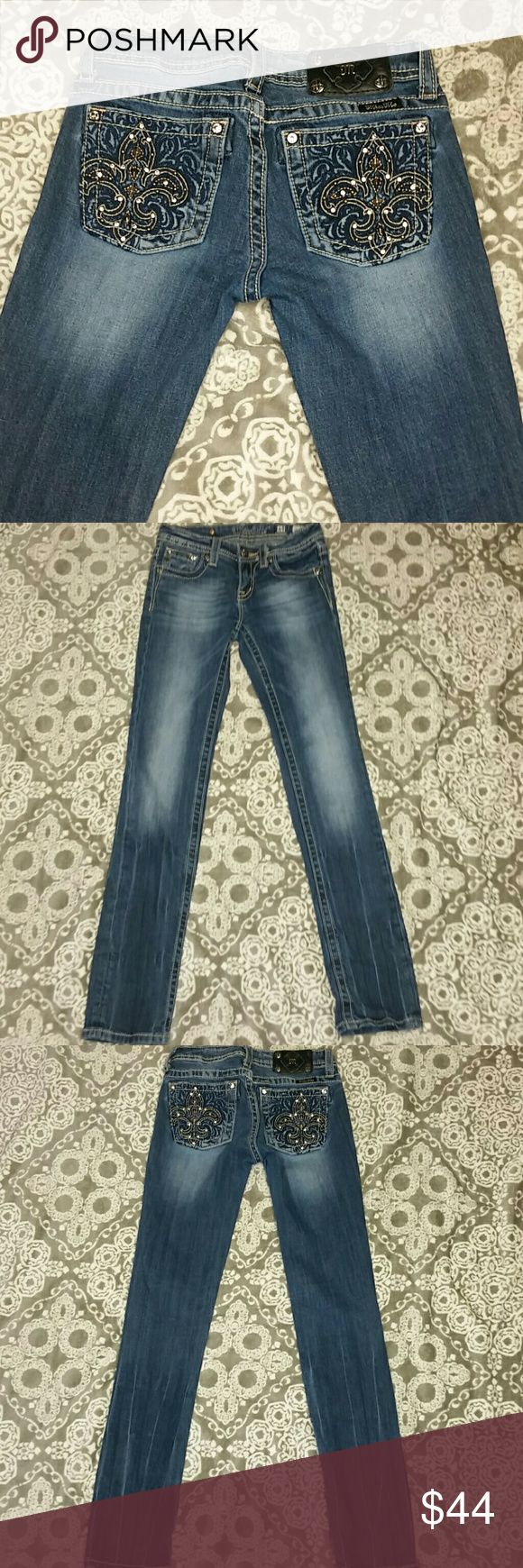 """Girls Miss Me Jeans Sz 14 Skinny Distressed Girls Miss Me Denim Distressed Jeans  Sz 14 Inseam from crotch to bottom: 31"""" Leg Opening: 5.5"""" Waistline: 12"""" 5 pockets, lower front rise and all studs are on. Great Condition. The lower legs have a distressed look to them that I believe is designed that way. PLEASE ask any questions. Back bottoms in excellent condition. Miss Me Bottoms Jeans"""